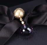 Ole Lynggaard. Ball clasp, 18 kt. satin-finish gold with diamonds and key pendant (2)