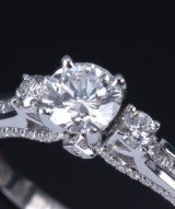 A diamond solitaire ring, 14 kt. white gold, total approx. 0.98 ct