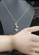 14kt heart shape necklace and bracelet set in gold