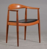 Hans J. Wegner. The Chair, mahogany with black leather