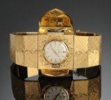Omega. Jewellery watch, 18 kt gold