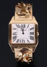 Cartier armbåndsur, Model 'Santos'. 18 kt guld.
