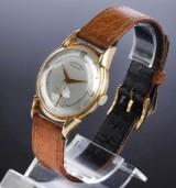 Favre-Leuba. Vintage herreur i 18 kt. guld med sølvfarvet skive, 1950´erne