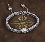 Shamballa. Diamond bracelet, 18 kt. white gold, with diamond ball, set with natural Fancy Intense Pink diamond, approx. 0.25 ct