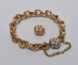 Ole Lyngaard. 'Mega' bracelet, 14 kt. gold with two 'Hyldeblomst' clasps in red and white gold (3)