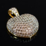 750 gold heart-shaped pendant with diamonds