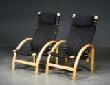 To lænestole med sorte fletgjorde, formspændte stel (2)