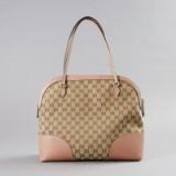 Gucci axelbandsväska med brunt monogrammönster