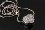 Ole Lynggaard. Brilliant-cut diamond heart clasp, 18 kt. white gold, & Bodil Binner necklace