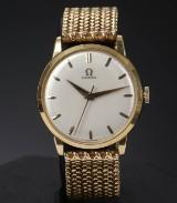 Vintage Omega herrearmbåndsur af 18 kt. guld.