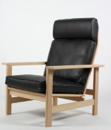 Søren Holst. High-backed easy chair, model 2461, oak and black leather