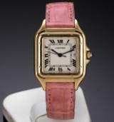 Cartier 'Panthere'. Midsize dameur i 18 kt. guld med original rem og spænde, 1990'erne