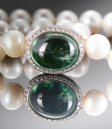 Ole Lynggaard. A large Emeli clasp with tourmaline and diamonds, approx. 0.48 ct, with freshwater cultured pearl necklace