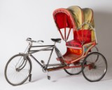 Rickshaw bicycle, India, two-seater, with covering, red-yellow