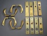 Arne Jacobsen. Fire sæt dørgreb af messing (4)