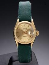 Rolex 'Datejust'. Dameur i 18 kt. guld med champagnefarvet skive, ca. 1966