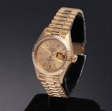 Rolex Datejust. Dameur i 18 kt. guld med champagnefarvet skive