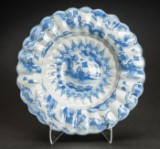 A large Baroque undulating dish, pale blue faience, end-17th century