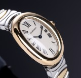 Cartier 'Baignoire'. Ladies watch, 18 kt. gold and steel with pale dial, 1990s