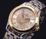 Omega 'Seamaster'. Men's watch, 18 kt. gold and steel with date