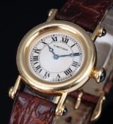 Cartier 'Diablo'. Dameur i 18 kt. guld med lys skive, 1990'erne