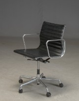 Charles Eames. Office chair in black leather, model EA117
