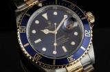 Rolex 'Submariner'. Herreur i 18 kt. guld og stål med blå skive, årgang 2008