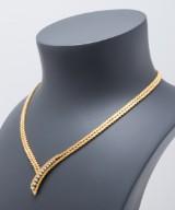 Vintage halskæde af 18 kt. guld med 11 diamanter, ca. 0.40 ct.