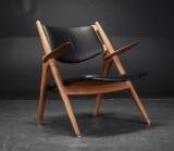 Hans J. Wegner. Sawhorse lounge chair in oak, model CH-28