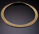 Kirsten Møller. A wide necklace, partly satin-finished 14 kt. gold
