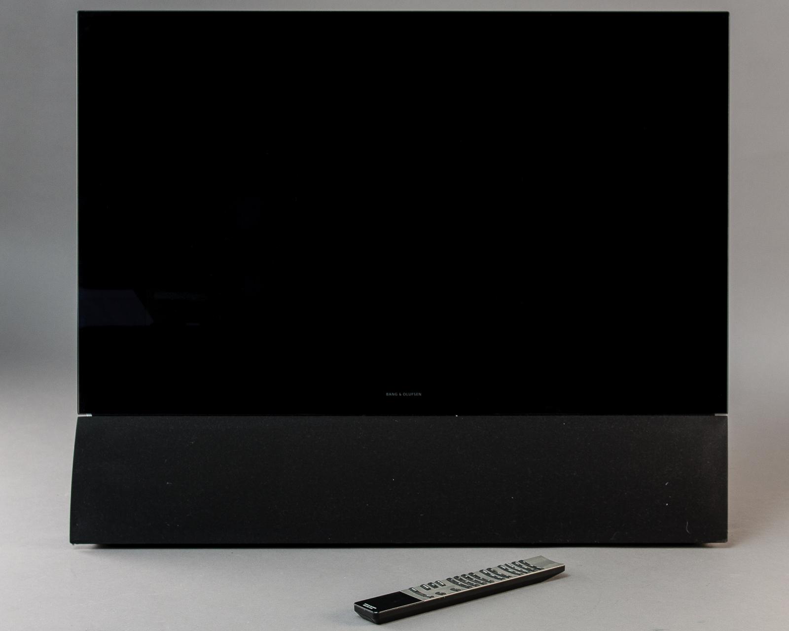 Bang & Olufsen, Beovision 6 / 26 med fjernbetjening - Bang & Olufsen, BeoVision 6 / 26 fladskærms-tv med Beolink 1000 fjernbetjening og vægbeslag. Alm. brugsspor. Lauritz.com indestår ikke for funktionaliteten