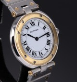 Cartier 'Santos Ronde' watch, 18 kt. gold and steel, white dial