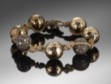 Frato. Woven bracelet with diamonds as well as gold and silver balls