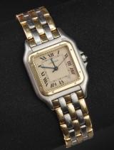 Cartier 'Panthere'. Herreur i 18 kt. guld og stål med cremefarvet skive.