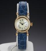 Cartier 'Diablo'. Dameur i 18 kt. guld prydet med safirer, ca. 1990