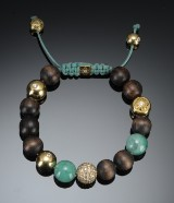 Shamballa. Bracelet with jade and wood beads, and diamonds