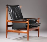 Finn Juhl. 'Bwana' easy chair, teak and black leather