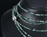 Ole Lynggaard. Kuglelås i 18 kt. blankt hvidguld samt treradet kæde med agater, perler og topaser (2)