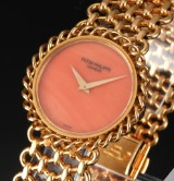 Patek Philippe. A rare ladies watch, 18 kt. gold with coral dial
