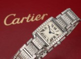 Cartier 'Tank Francaise'. Ladies watch, steel with numerous diamonds