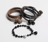 Ole Lynggaard. Onyx bracelet with 14 kt. white gold Heart clasp with diamonds, three Sweet Drops and two Sweet Drops leather bracelets