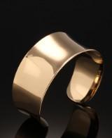 August Ehlers. Wide, smooth 14 kt. gold bracelet
