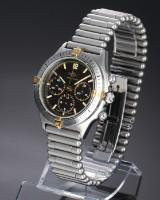 Breitling 'Callisto Chronograph'. Herreur i 18 kt. guld og stål med mørk skive, 1990'erne