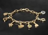 Charm bracelet 8 brilliant-cut diamond and gemstone encrusted charms