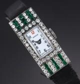 Editor. Art deco dameur i stål med diamanter og smaragder, 1920'erne