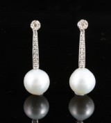 Diamond and south sea pearl earrings in gold approx. 0.30ct