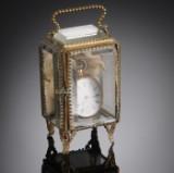 Damelommeur af guld 18 K med tilhørende montre. (2)