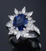 Sapphire and diamond rosette ring, 18 kt. white gold, 20th century-second half