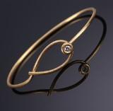 Marianne Dulong. 'Kharisma' bangle, 18 kt. satinated gold, brillliant-cut diamond