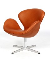 Arne Jacobsen. The Swan easy chair, cognac-coloured leather
